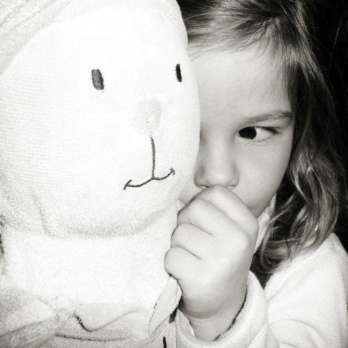 Shy female pediatric with stuffed toy