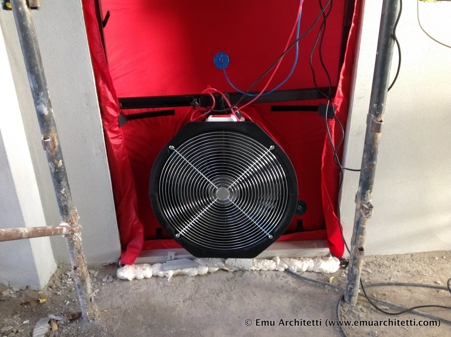 the fan that pushes air in or out of the sealed area - blower door test
