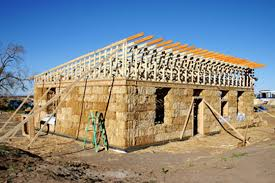 A straw bale house under construction.