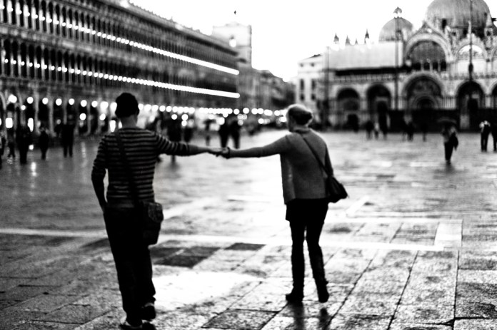 Couple of tourists in S. Marc square, Venice.