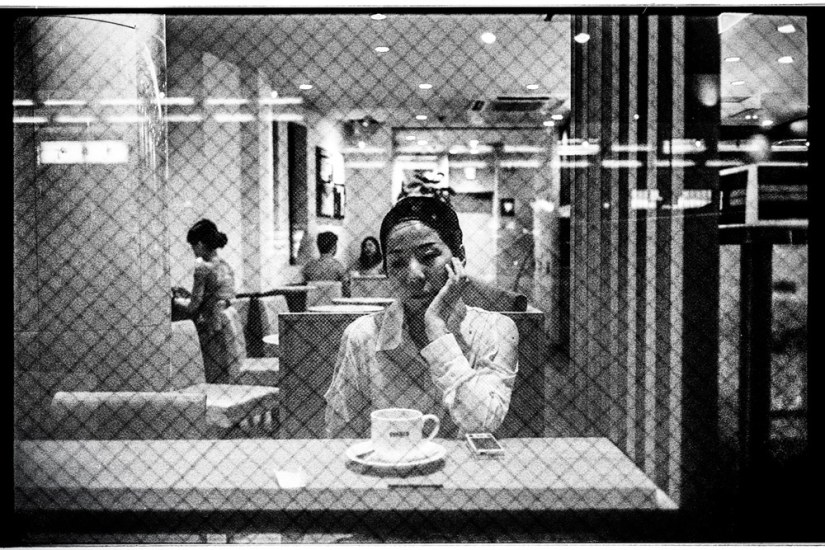 A woman deep in her thoughts in a cafe' in Kyoto.