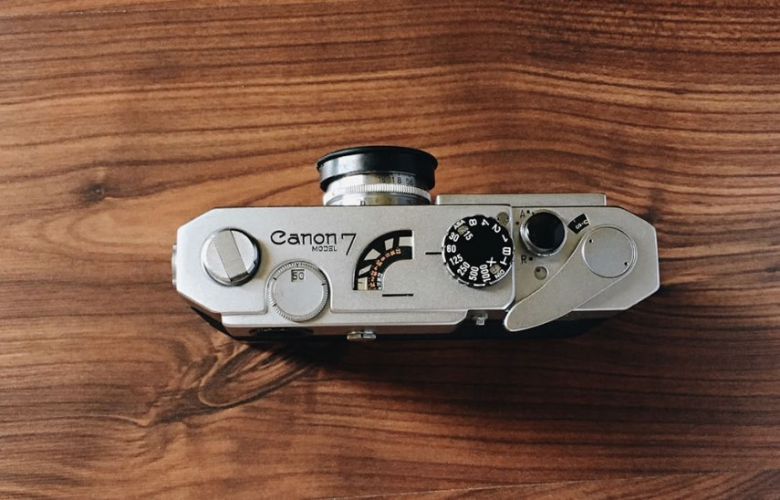 Canon 7 - From the left- film rewind knob, viewfinder frame line setting knob, meter, ASA/shutter speed, shutter button with soft release. The collar around the shutter release has settings: A for frame advance and R for rewind. The red dot is shutter lock. Underneath is a film indicator- it spins as the film advances. Watch it on rewind and stop when it stops to take the cartridge out before the film retracts inside. The frame counter and advance lever round out the top of the camera.