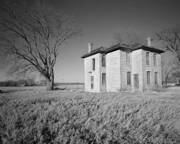 Boarded up villa, north of Lawrence, KS. Kodak T-Max 100. 150mm lens w/orange filter.