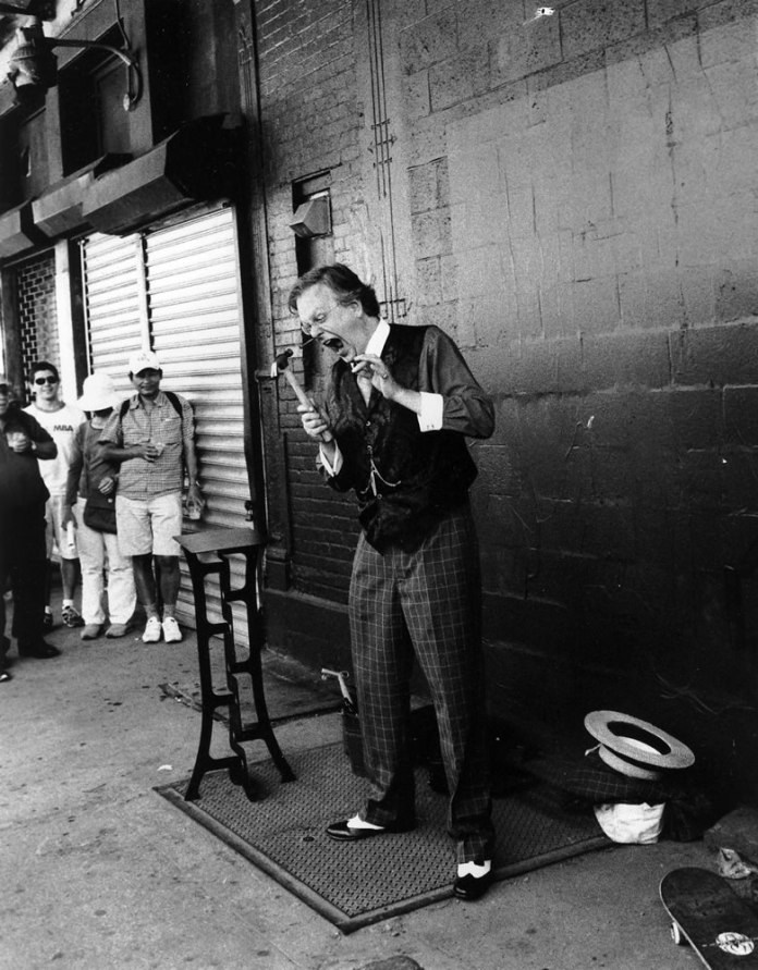 Performer hammering a 6-inch nail up his nose, Fuji Neopan 1600 at 800, HC110 Dil. H