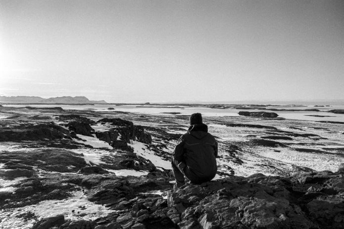 Reviewing the landscape near Dalabyggð. Zuiko 28mm F2.8; Auto shutter at f/8; PAN F in Ilfotec DD-X.