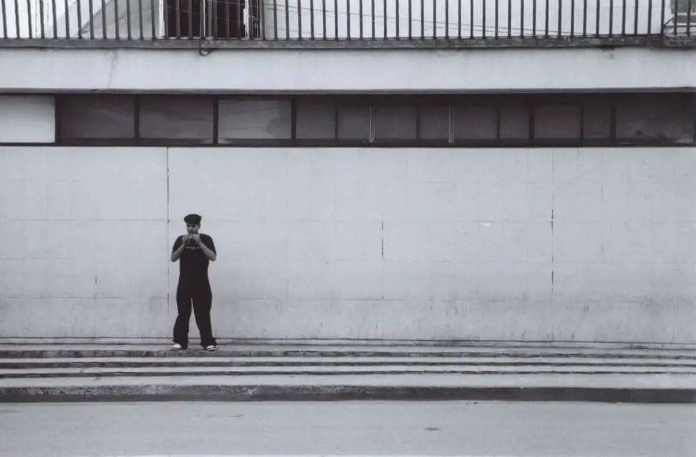 Standing in Nogales, Canon AE-1 Program, 50mm 1.4, Kodak BW400CN
