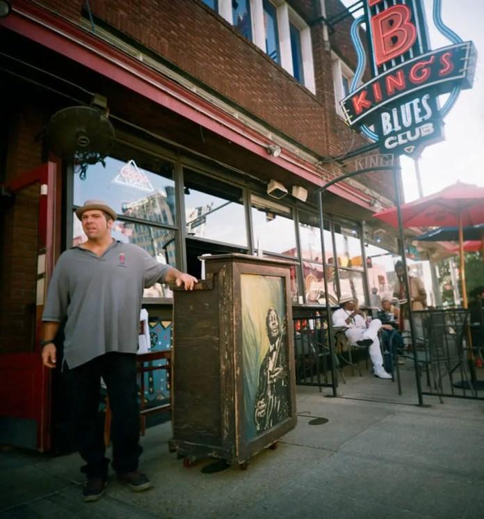 Beale Street in Memphis. Velvia 100. Shot from the hip.