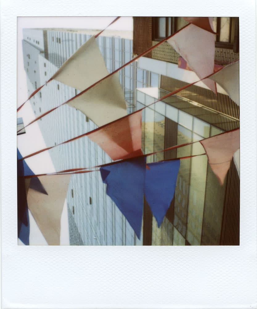 """Flags"" (NYC 2015) - Polaroid SX-70 Alpha 1 Land Camera with expired Polaroid 600 film and ND pack filter"