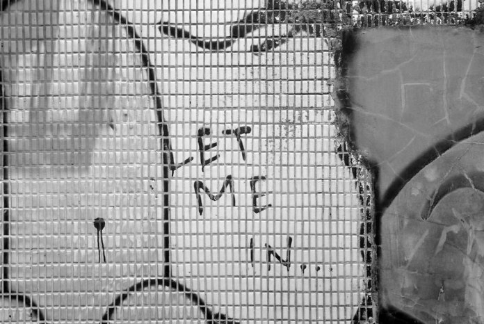Let me in - Shot on Kodak T-MAX 100 at EI 100. 35mm Black and white film in 35mm format.