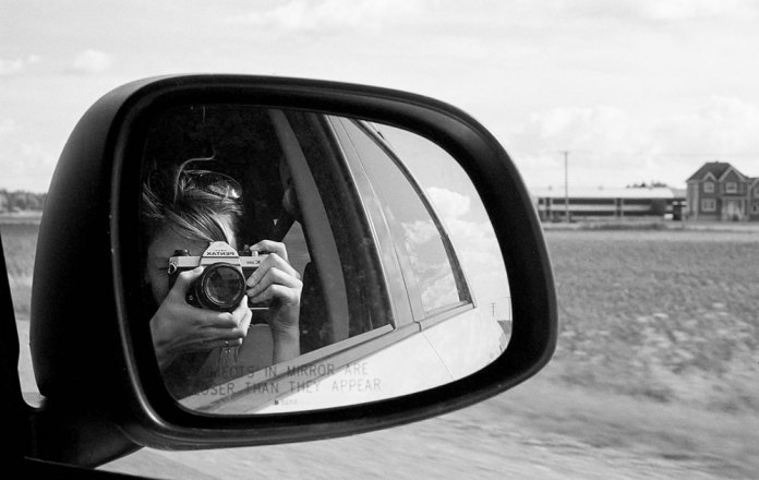 Self Portrait - A shot whizzing down the highway on my way to the farm. Pentax K1000, ILFORD HP5+