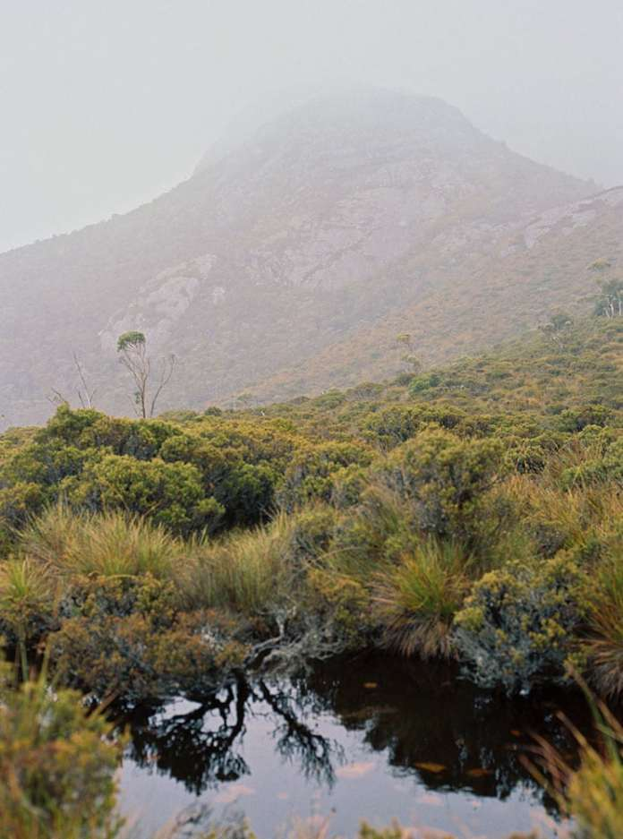 Tasmania Travelogue - Mist almost obscures the mountain in Cradle Mountain National Park.