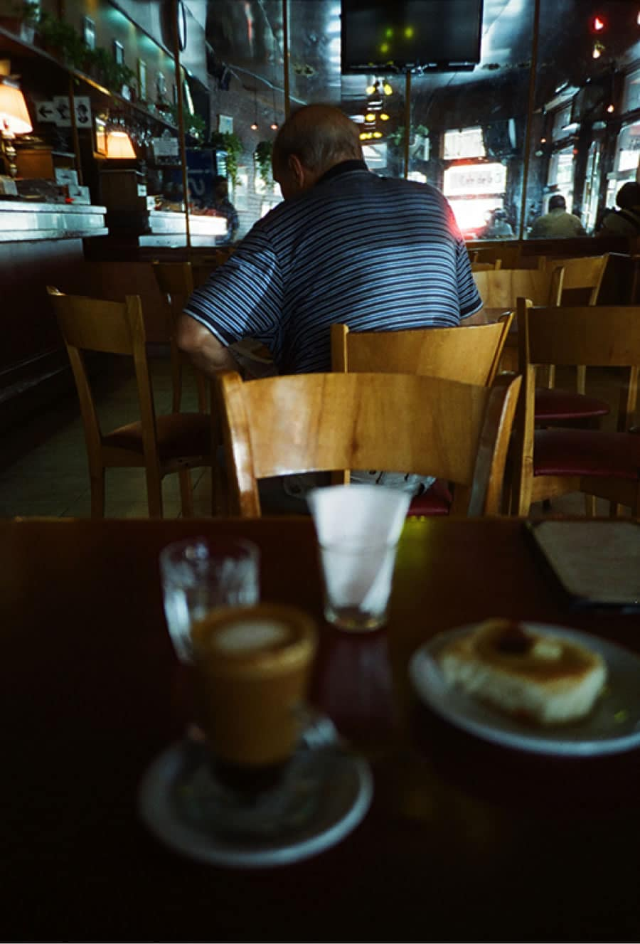 Cinestill 800T shot with a Lomo LCA+ in a Buenos Aires café.