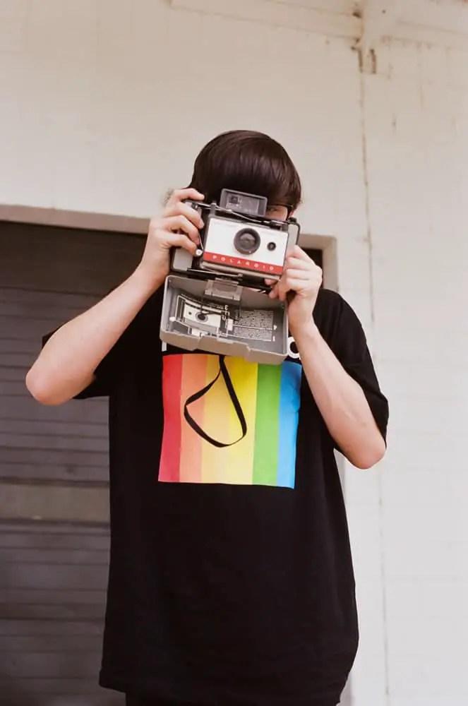 Son with Polaroid Land Camera
