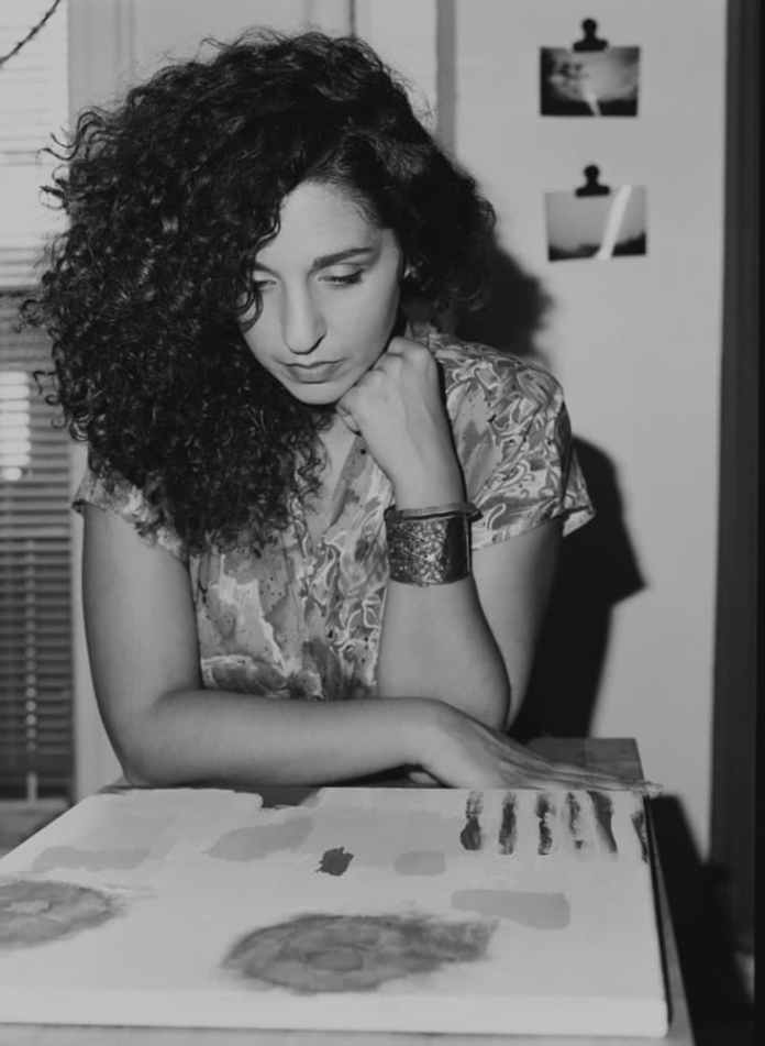 This photographic frame has the painter Rosa Russo in the middle of its composition. Photographed on Ilford FP4+, Medium-format film. Braun on the camera flash was used for this frame. I wanted to light her, & her painting with a tide of light that covered her, her painting & her beautiful hair. What is a continuity compliment to Ilford film's photographic sciences is that they built their visual signature off of the B&W serious to details, structure (all of which comes through, visually & successfully with the tide of light that I used for this frame). From the ingredients on how they chemically produce their film to the process and development chemistry, down to the paper that they create–it is about fulfilling a B&W visual that belongs to their vision. This is the benefit that arrives with B&W film photography, overall. No film manufacturer desire to have their B&W film look like their competitors.