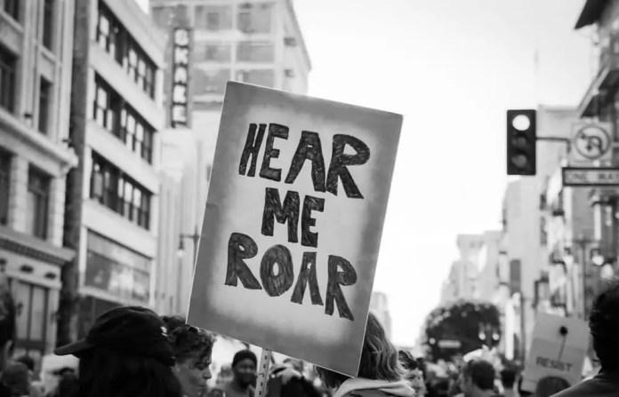 Hear me roar - Women's March, Los Angeles. Canon EOS-3, Fujifilm Acros 100