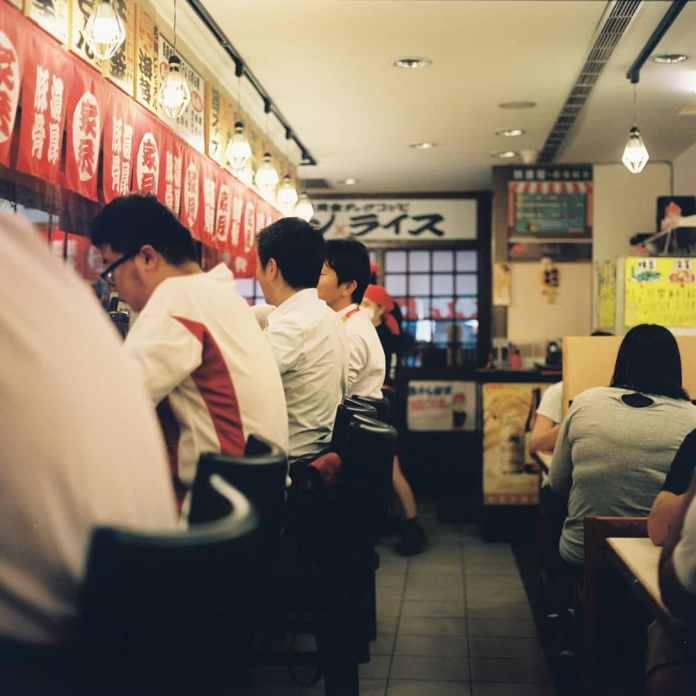 Salarymen - Shot on Kodak Portra 400 at EI 400. Color negative film in 120 format shot as 6x6.