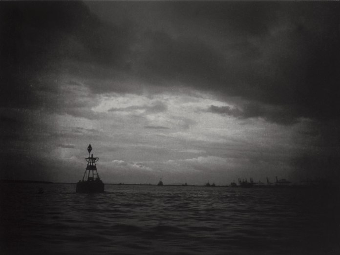 """Untitled"", Malacca Strait. Fuji GS645S, 60mm f/4.0, loaded with ILFORD Pan F+ exposed at EI 50, developed in Adox Rodinal 1:50. The porthole was dirty, which created this kind of vignetting and slight distortions in the image."