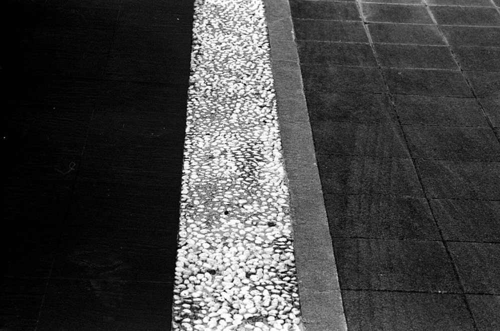 Lines - Shot on Silberra ULTIMA 200 at EI 200. 35mm black and white format film. Orange #25 filter. Leica M6 / Leica Tele-Elmarit 90mm f/2.8.