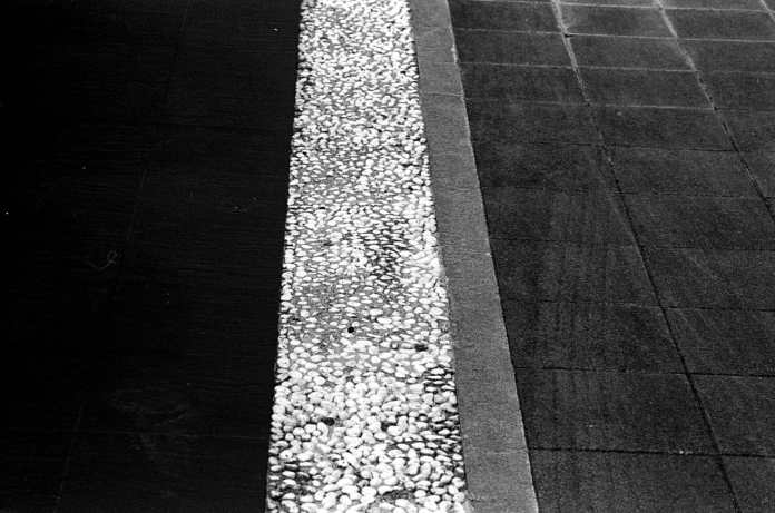 Lines - Shot on Silberra ULTIMA 200 at EI 200. 35mm black and white format film. Orange #25 filter. Leica M6 / Leica Tele-Elmarit 90mm f/2.8.