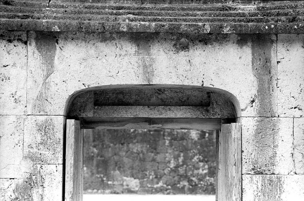 Top entrance - Shot on Silberra ULTIMA 200 at EI 200. 35mm black and white format film. Orange #25 filter. Leica M6 / Leica Tele-Elmarit 90mm f/2.8.
