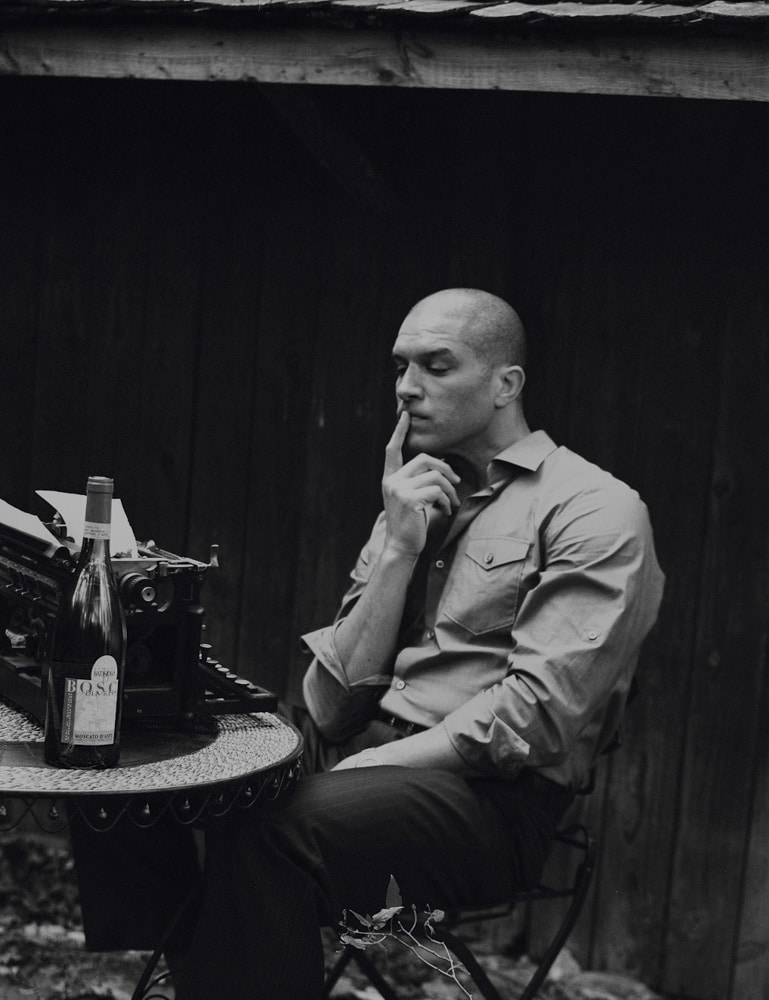 Ponder in Growth. Photographed on Kodak medium-format film with my Mamiya RB67. Harlem, New York. All natural light was used for this frame with the actor Terrell Tilford. I was pleased with how the light shaped the table, typewriter & bottle of wine, as well as the chair & plant that is in the frame.