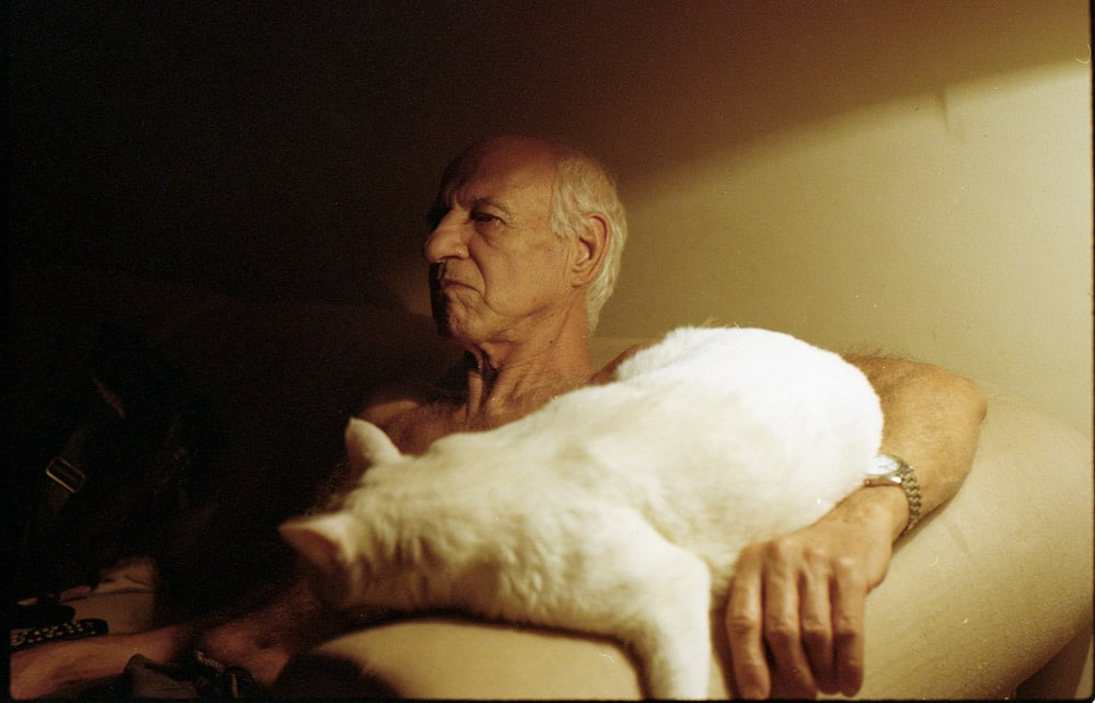 My grandfather Paulo, watching TV with Charlote. Shot on Kodak Portra 400