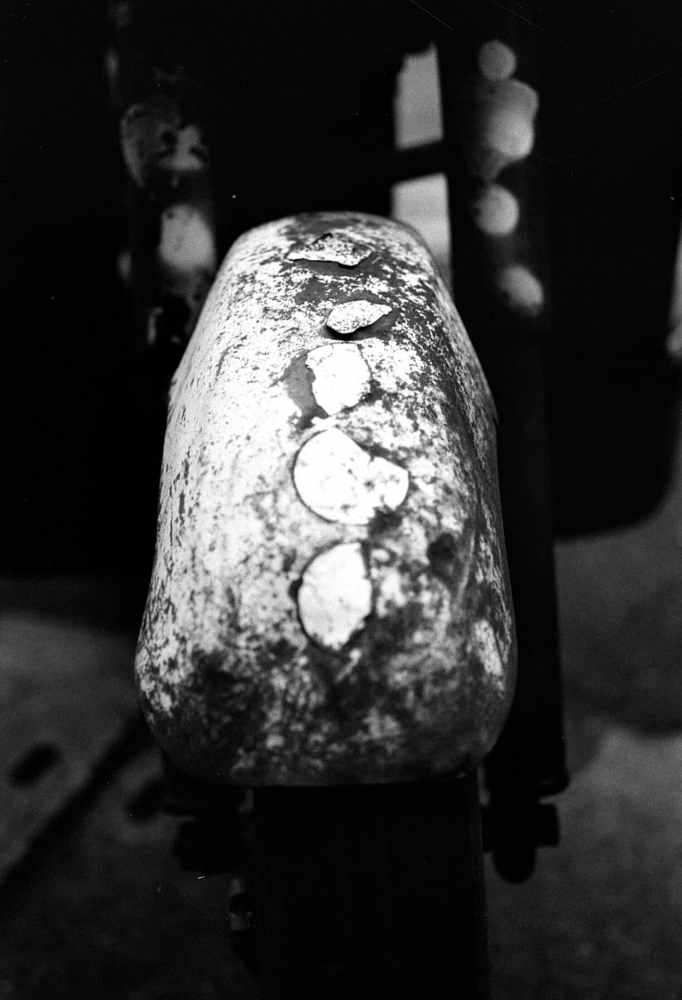 Mudguard - Shot on Kosmo Foto Mono 100 at EI 100. Black and white negative film in 35mm format.