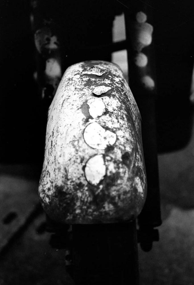 Mudguard - Shot on Kosmo Foto Mono 100 at EI 100. Black and white negative film in 35mm format.