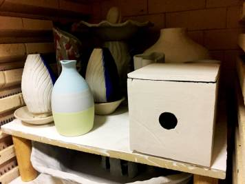 The Ceramic Pinhole Project - Ceramic pinhole camera in kiln for second firing