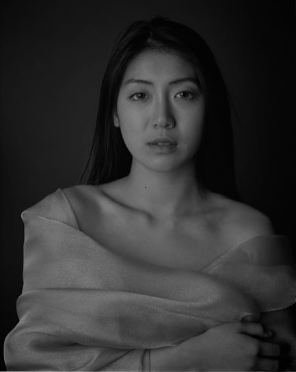 This was my first attempt at shooting portraits with FP4 PLUS at box speed (125 ISO).Although the shot is nice enough, There is very little detail in the hair and the shadows are quite blocked out. To get a better negative I needed to increase exposure - Tobias Key