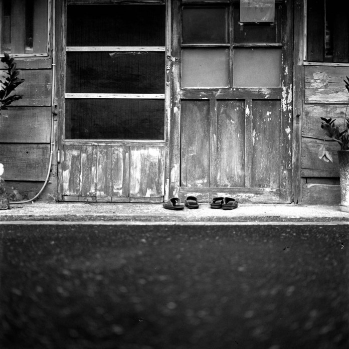 Off at the door - Shot on Silberra ULTIMA 200 at EI 200. Black and white negative film in 120 format shot as 6x6.