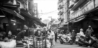 Day market 01 - Shot on ILFORD Delta 100 Professional at EI 100. Black and white negative film in 120 format shot as 6x12.Push processed one stop.