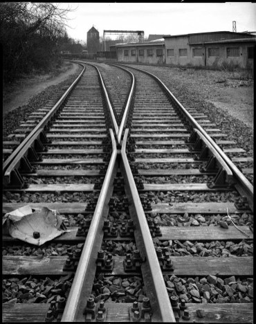 Railroad tracks, Schneider Symmar 150mm, asynchronous lens tilt to extend plane of focus from front to back, Ilford HP5+ in Rodinal 1+50.jpg