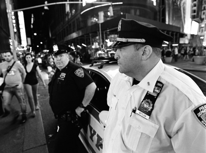 Officer, Times Square, NYC - Mamiya 645E 35mm f/3.5 @f/3.5 - ILFORD Delta 400 Professional, EI 800