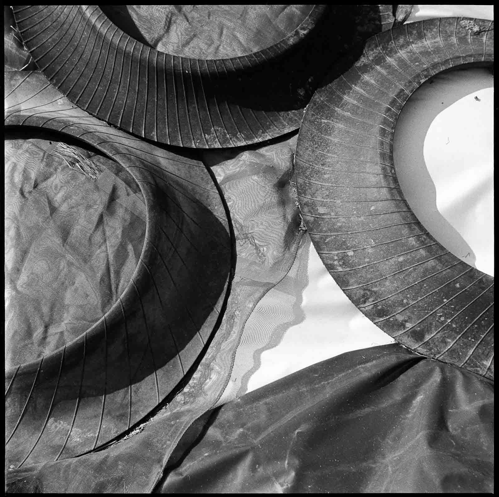 Tarpaulin covers and tyres shot on Ilford Pan F, HC110 solution E