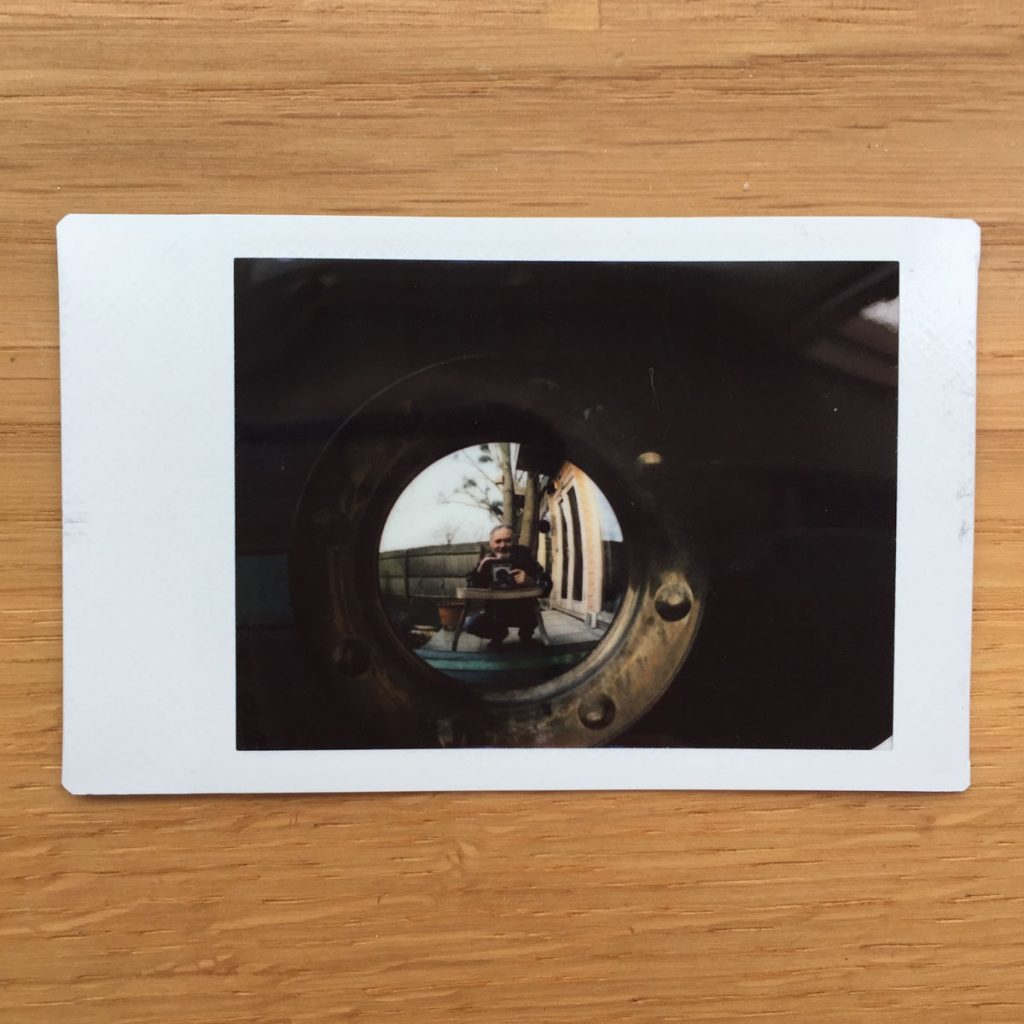 Instax Mini selfie in convex mirror