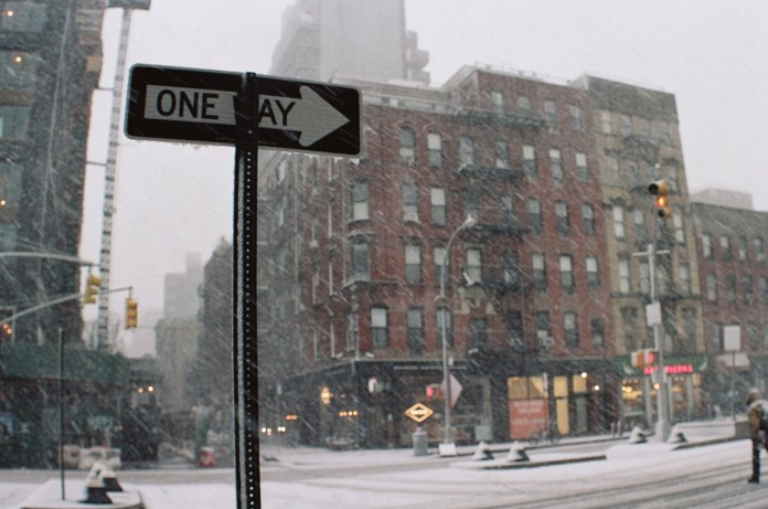 Canon Elan 7 with Pentax 6x7 35mm Fisheye lens. Kodak Portra 160. Snapshot in a snowstorm on Houston St. in New York City.