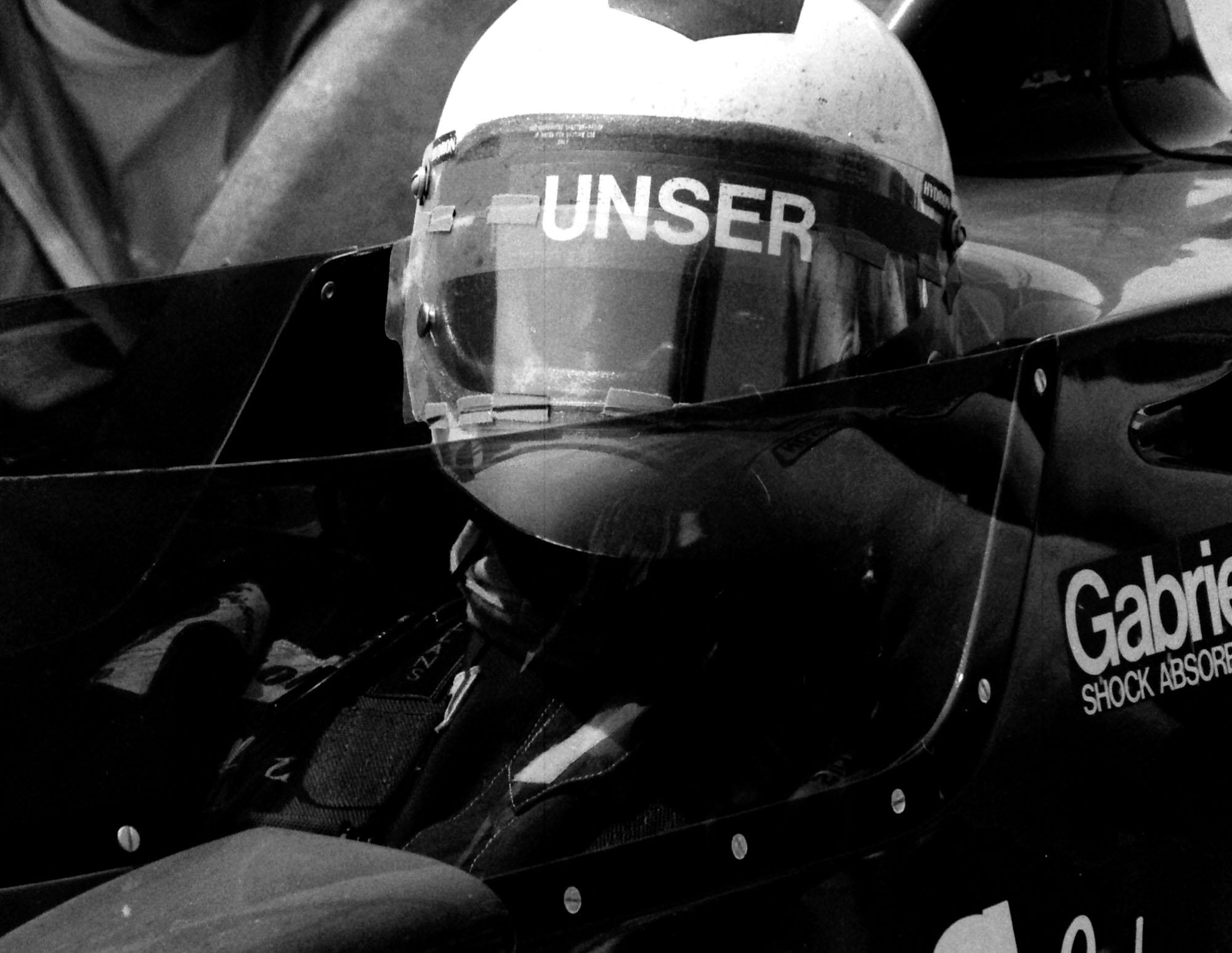 American Racing Wheels Car 21 Al Unser Up close with helmet on - Dan Carroll