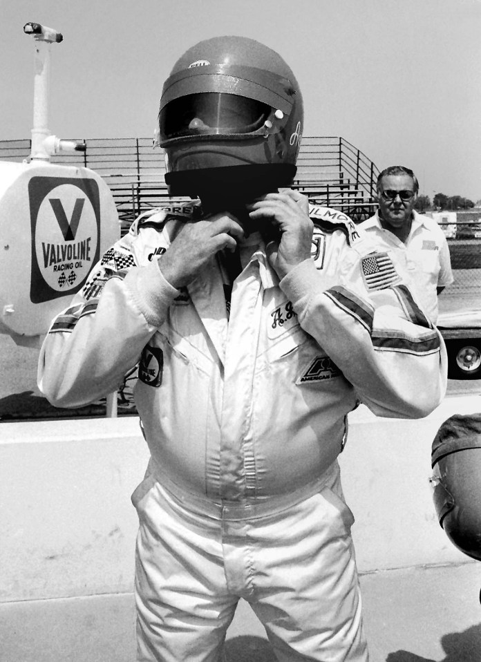 Filmore Racing Team Car 14 AJ Foyt Jr. Strapping Helmut - Dan Carroll