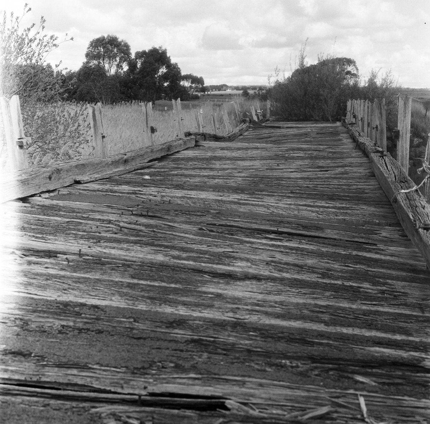 Remains of a bridge  Film: Kodak Tri-X Lens: 80mm f/2.8 Exposure:  not recorded  Near Lancefield, Vic, Australia.