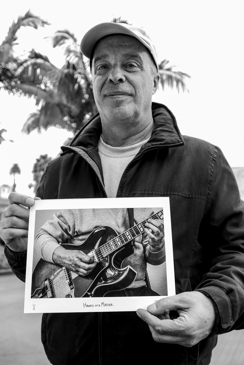 Alberto Negroni with his print that flew home with him to a city outside of Venice, Italy