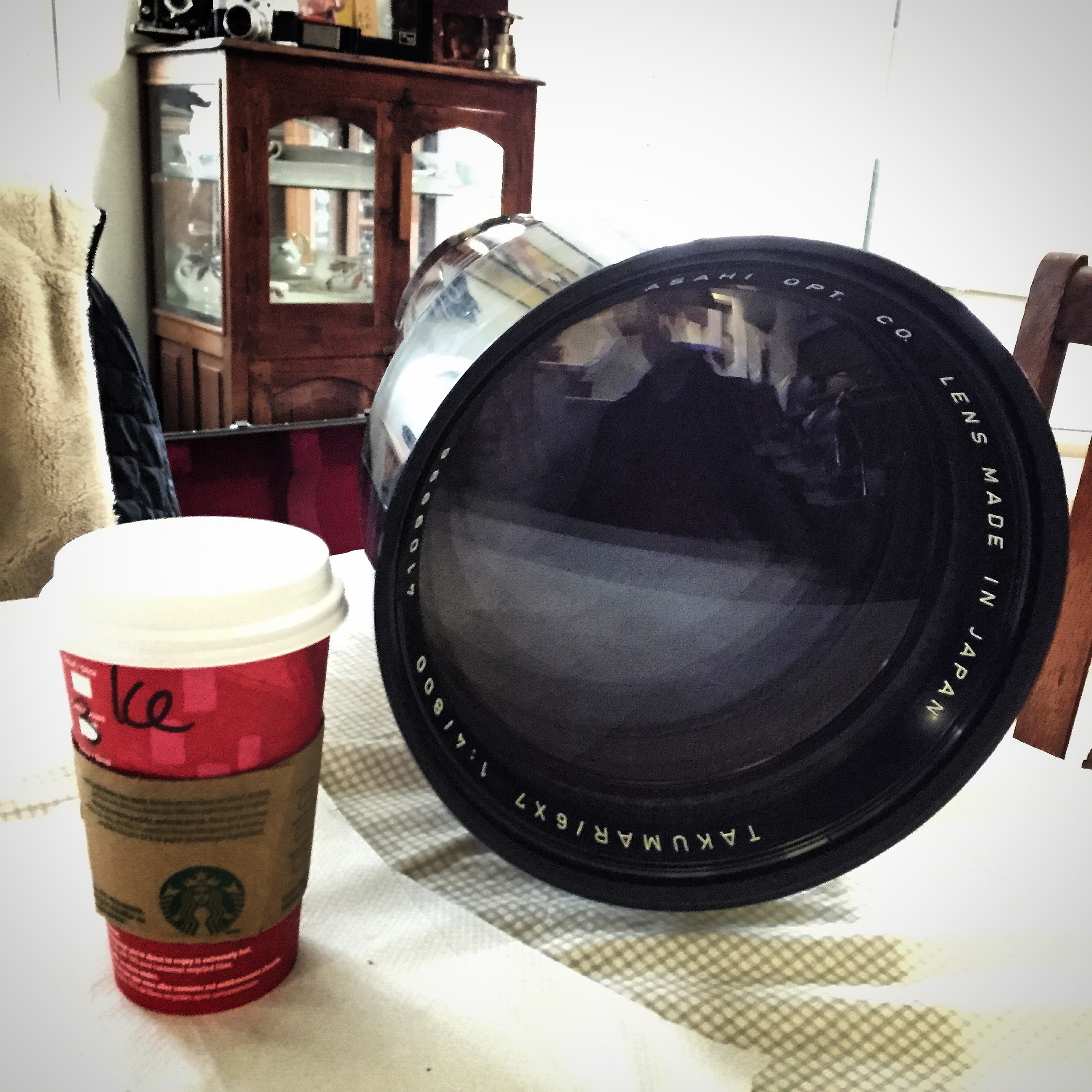 That's a Grande Starbucks Cup by the way. Two guesses where this lens goes.