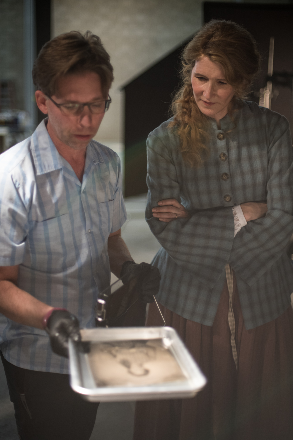 BTS Wilson Webb showing Laura Dern the wet plate development process (Credit Kimberly Scarsella)