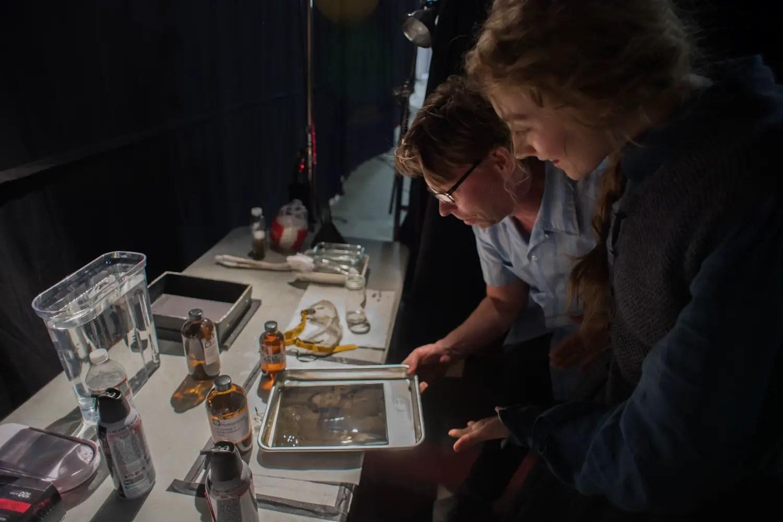 BTS Wilson Webb showing Saoirse Ronan the wet plate development process - Credit Kimberly Scarsella, Little Women (2019)