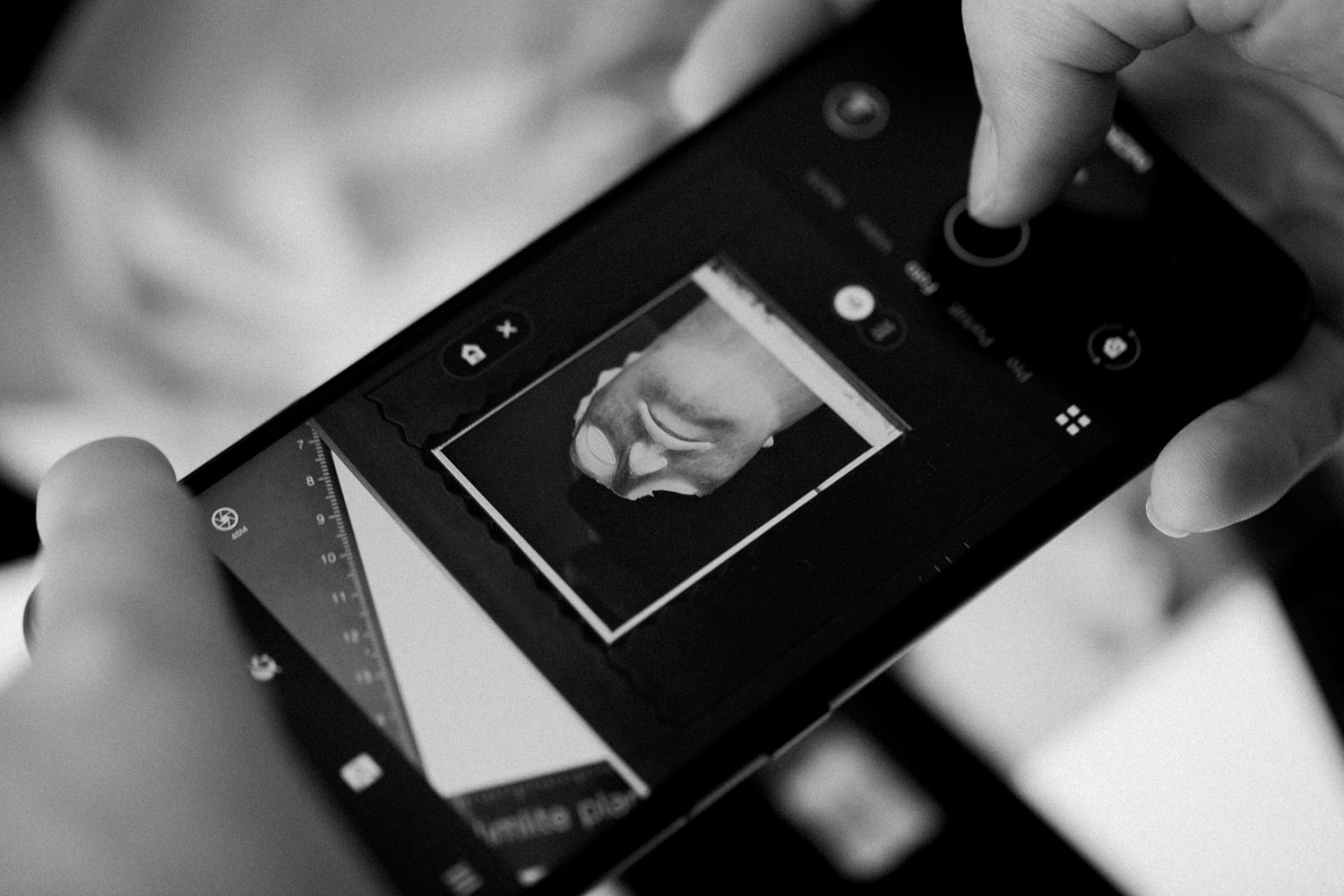 Scanning film negatives with a mobile phone. Credit: Ludwig Hagelstein