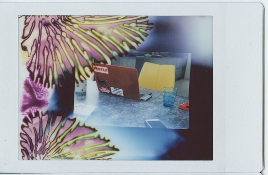 A sheet of Instax Mini when pulled too fast through the rollers - Fujifilm Instax Mini in a 35mm camera