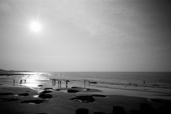 Life's a beach - Shot on Kodak T-MAX 100 at EI 100. Black and white negative film in 35mm format.