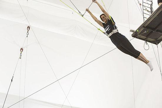 OnDeck's CMO Andrea Gellert flying. Photo by Kate Glicksberg.
