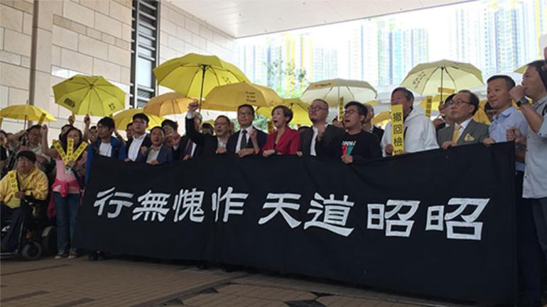Supporters rally for nine prominent figures of Hong Kong's 2014 Occupy Central pro-democracy movement who went on trial on on public order charges, Nov. 19, 2018.