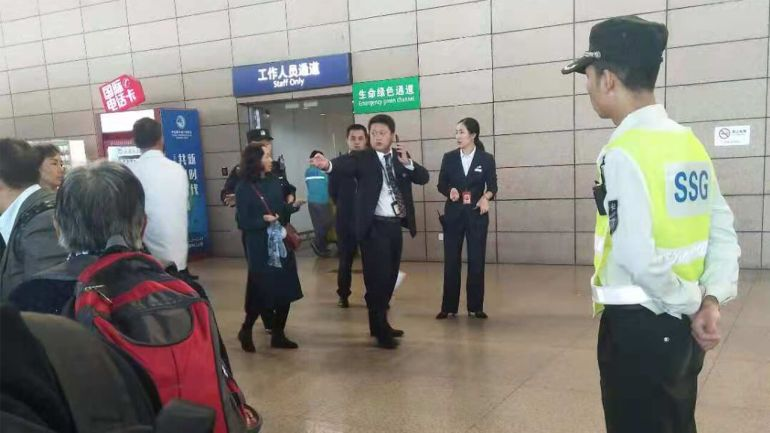 Chinese state security agents stop house-church Christians from boarding a plane in Shanghai to attend a training session in South Korea, Oct. 25, 2018.